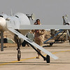 US Air Force (USAF) Staff Sergeant (SSGT) Jeffrey Hicks, with the 46th Expeditionary Reconnaissance Squadron (ERS), performs a basic post flight inspection of a RQ-1 Predator aircraft at Tallil Air Base (AB), Iraq, in support of OPERATION IRAQI FREEDOM.  The Predator is a remotely piloted Umanned Aerial Vehicle (UAV) that provides real-time surveillance imagery.