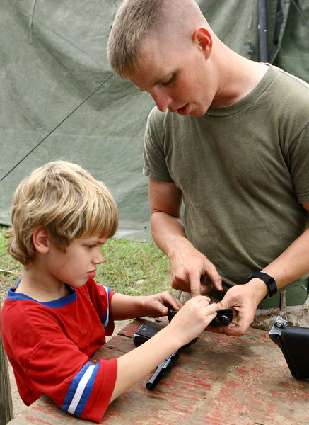 Ira, learning from the world's finest, how to assemble and disassemble a 9mm pistol.
