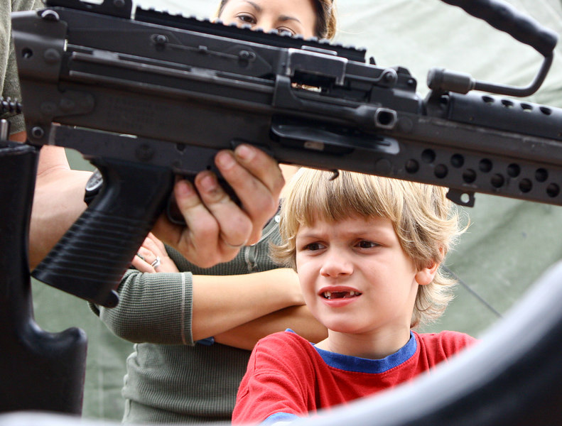 """Ira, learning from the world's finest, how to assemble and disassemble a SAW (Squad Assault Weapon). He's thinking, """"I bet I can make THAT baby ROCK!!"""""""