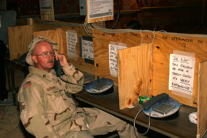 Me trying to make a phone call home from Egypt September and October, 2005. Taken by my GREAT friend, Staff Sergeant Donnie Reeves. Love ya, Donnie! You are the best!!