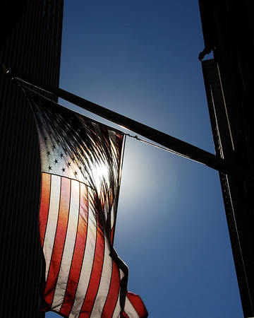 Flag with Sun backdrop in downtown Chicago, Illinois
