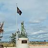Mia/Kia Flag with Memorial Statue