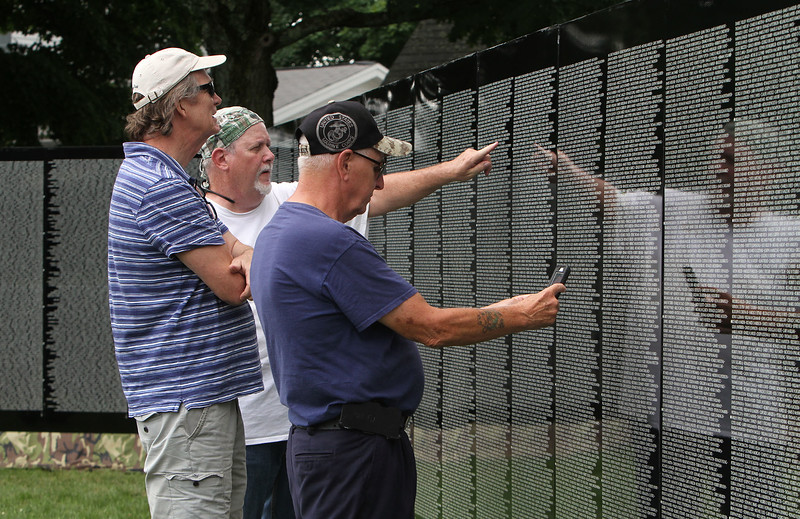 The Moving Wall Vietnam Veterans Memorial is set up on Wilmington Common. From lefrt, Tim Powers of North Reading, his friend Charlie Murray of Medford, and Viincent Dwyer of Wilmington. (SUN/Julia Malakie)