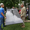 The Moving Wall Vietnam Veterans Memorial is set up on Wilmington Common. Omar Eldaly, 17, of Wilmington, a rising senior at Shawsheen Tech, and Army National Guard PVT Bryan Tapia of Lawrence carry a panel. (SUN/Julia Malakie)