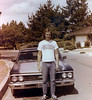 Kid before Marine Corps boot camp in front of my Chevelle which I miss.