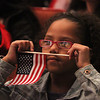 Send-Off Ceremony for Army National Guard 1060th Transportation Company, deploying tomorrow and eventually to Kuwait in support of Operation Enduring Freedom - Spartan Shield. Analis Byno, 8, of Cambridge watches the ceremony. Her uncle is being deployed. (SUN/Julia Malakie)