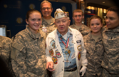STC (SS) Howard Snell USN (Ret) was stationed at Submarine Base, Pearl Harbor. He is also a veteran of the Battle of Midway. Posing with members of the George Washington High School ROTC.