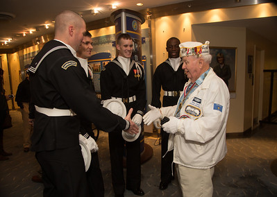 STC (SS) Howard Snell USN (Ret) was stationed at Submarine Base, Pearl Harbor. He was also a veteran of the Battle of Midway. Here meeting members of the U.S. Navy Ceremonial Guard.