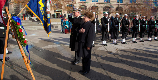 Rear Adm. Patrick Lorge, U.S. Navy, Commandant of Naval District Washington, and Rear Adm. Kleber Masterson, USN (Ret.) laid a wreath at the foot of The Lone Sailor statue in remembrance of those who died on December 7, 1941.  Rear Admiral Masterson's late father was a Pearl Harbor survivor. The ceremony took place at the US Navy Memorial in Washington DC. on Dec. 7, 2010. (Photo by Jeff Malet)