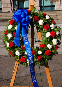 Rear Adm. Patrick Lorge, U.S. Navy, Commandant of Naval District Washington, and Rear Adm. Kleber Masterson, USN (Ret.) laid a wreath at the foot of The Lone Sailor statue in remembrance of those who died on December 7, 1941.  Rear Admiral Masterson's late father was a Pearl Harbor survivor. The ceremony took place at the US Navy Memorial in Washington DC. on Dec. 7, 2010.