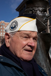 "On Tuesday December 7th, 2010, the Navy Memorial located in Washington DC honored the memory of the 69th anniversary of the bombing of Pearl Harbor. At 1:00 P.M., the Navy Memorial held a wreathlaying ceremony outside on the plaza in memoriam of the attacks with the following speakers and survivors in attendance. 88-year old Pearl Harbor survivor Frank Yarnick, Sr. took part in 10 major battles in the Pacific. The ""Lone Sailor"" statue of the US Navy Memorial in rear."