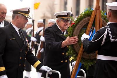 """Rear Admiral Patrick J. Lorge and Commander John Budzik, USNR (Ret) in background on left Rear Admiral Edward K. """"Ted"""" Walker Jr., SC, USN (Ret)"""