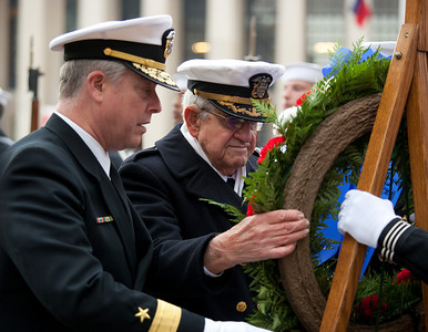 Rear Admiral Patrick J. Lorge, Commandant, Naval District Washington, Deputy Commander, Joint Forces Headquarters, National Capitol Region  Pearl Harbor survivor Commander John Budzik, USNR (Ret) was awarded the Bronze Star Medal for his service as commander of Abele during the Okinawa campaign.