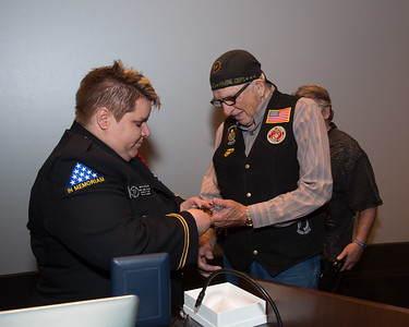 E. Bruce Heilman, former Chancellor at the University of Richmond. He was a U.S. Marine during the World War II Pacific Campaign. He will ride his Harley-Davidson motorcycle in the Memorial Day Parade. Here receiving a challenge coin from the New York State Director of Bugles Across America.