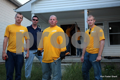 "08/18/11- Navy volunteers in the tradition of ""Seabees"" participate in renovation projects in inner city sites around Indy. pictured above from left to right HM2-Mike Unruh, LS1 Vargo  Gregory, Bryan Hall and Nick Allen. Photo/Ron Foster Sharif"