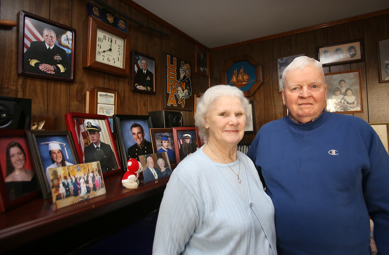 Arthur and Patricia Brown of Lowell, who have three sons and three grandsons in the Navy. Their son Richard, in picture at top left on wall, is being promoted to vice admiral.  (SUN/Julia Malakie)