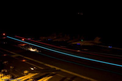 Another night landing.  The sparks are from the arresting hook striking the flight deck.