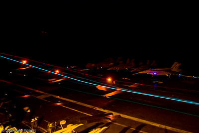 Night landing long exposure.  You can see the aircraft illuminated by the top strobe.