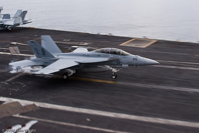 "An F/A-18F ""Super Hornet"" touches down."