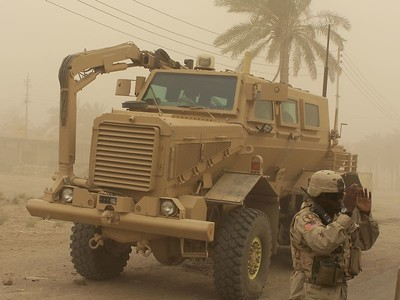 The spindly-clawed Buffalo armored vehicle digs through Baghdad's rubble piles, looking for improvised bombs.