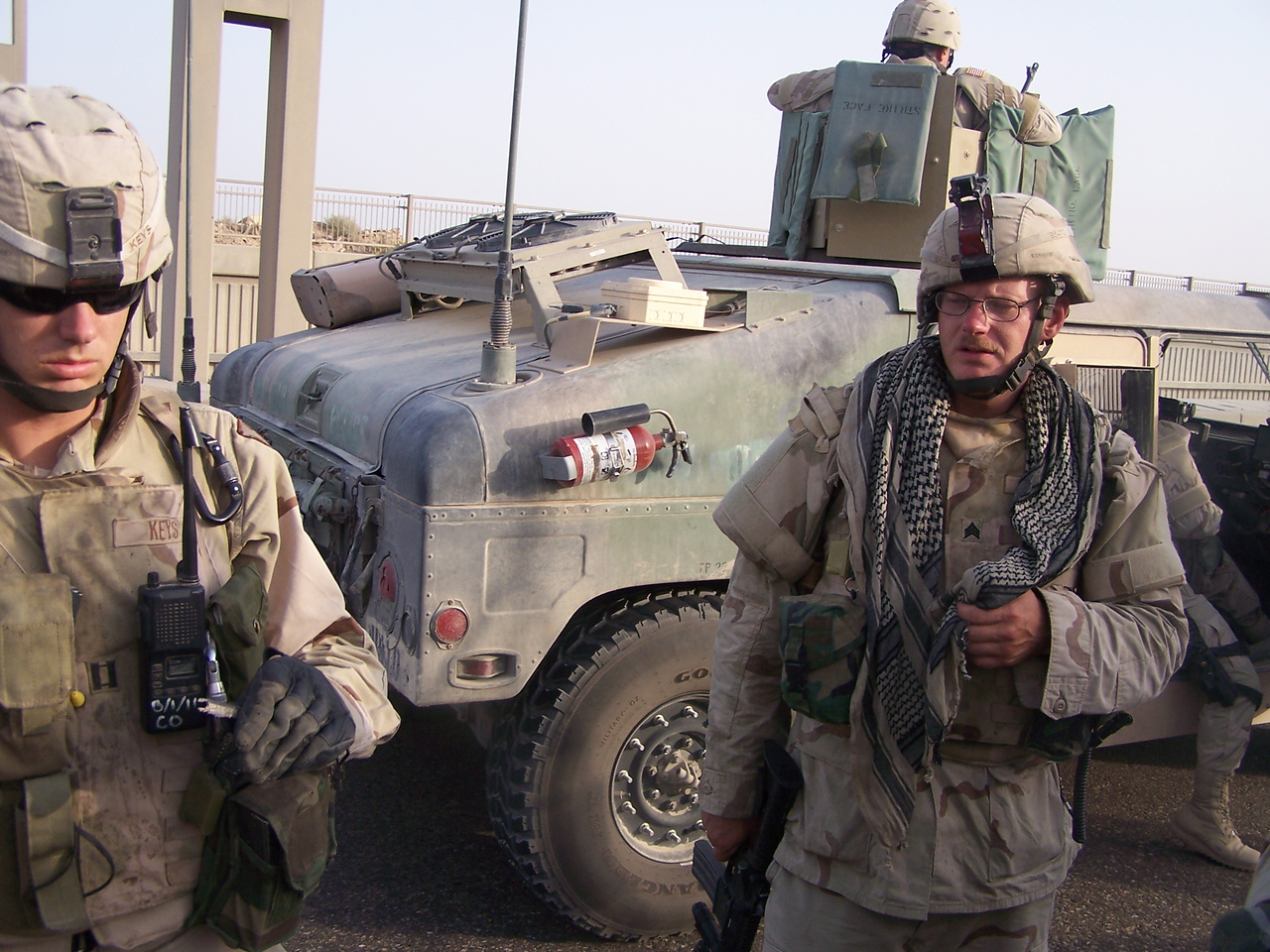 "Members of the ""Joint IED Defeat Task Force,"" looking rather defeated.  They wandered this highway for hours, picking up bombs remnants by hand.  Other soldiers took bets on whether they would survive their tour of duty."