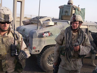 """Members of the """"Joint IED Defeat Task Force,"""" looking rather defeated.  They wandered this highway for hours, picking up bombs remnants by hand.  Other soldiers took bets on whether they would survive their tour of duty."""