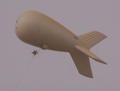 A pair of aerostats watch over Camp Victory, the American military headuqarters in Iraq.