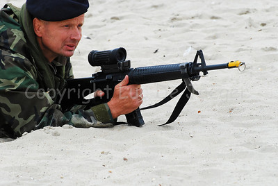 Dutch Royal Marines on the sand in Ostend (Oostende), Belgium after an amphibitious landing on a beachhead during Operation Storm Tide, a Field Training Exercise (FTX) in cooperation with Belgian Paratroopers. The Dutch marines handle the Diemaco C7A1 assault rifle with Elcan sight.