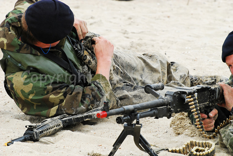 Dutch Royal Marines on the sand in Ostend (Oostende), Belgium after an amphibitious landing on a beachhead during Operation Storm Tide, a Field Training Exercise (FTX) in cooperation with Belgian Paratroopers. The marine in front handles the FN MAG machine gun.