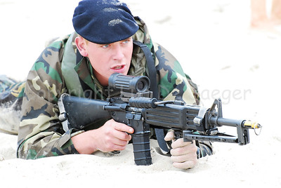 Dutch Royal Marines on the sand in Ostend (Oostende), Belgium after an amphibitious landing on a beachhead during Operation Storm Tide, a Field Training Exercise (FTX) in cooperation with Belgian Paratroopers. This Dutch marine handles the Diemaco LOAW assault rifle with Elcan sight.