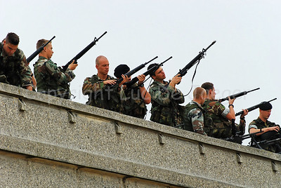 Dutch Royal Marines testing their rifles on top of the Koninklijke Galerijen (Royal Galleries) along the Beach Promenade (Zeedijk) in Ostend (Oostende), Belgium, during operation Storm Tide, a Field Training Exercise in cooperation with Belgian paratroopers.