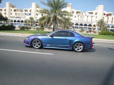 Not military but anyway..... a gorgeous irridescent blue/purple Saleen Mustang Cobra.  Photo taken on the main road into Muscat.