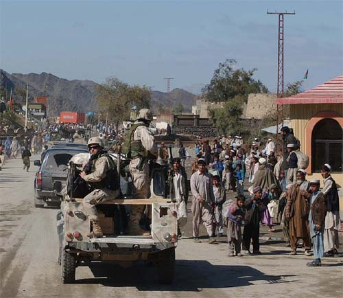 Soldiers drive through the village of Torkham, Afghanistan, in the Khyber Pass, following a border security meeting in Pakistan.