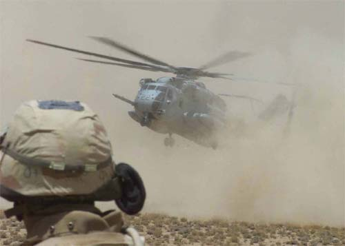 A CH-53E Super Stallion lands amid billowing clouds of dust during a resupply mission in Afghanistan's Oruzgan.