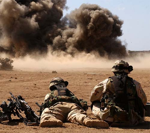 Soldiers watch as explosives detonate during a training exercise on a range in rural Djibouti.