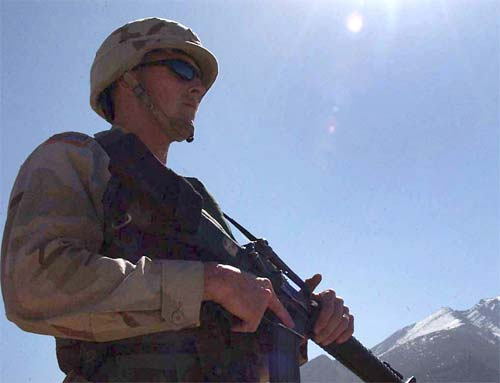 A Soldier pulls security during a school opening in Kabul, Afghanistan.