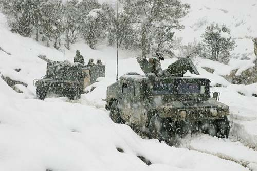 Marines conduct a mounted patrol in the cold and snowy weather of the Khowst-Gardez Pass, Afghanistan. in order to disrupt any enemy activity.