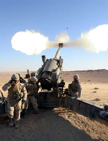 A 155 mm high-explosive artillery shell is blasted skyward in the Al Anbar Province of Iraq. Capable of impacting targets as far as 18 miles away, the unit's M198 Howitzers were fired to help the Marines both hone their skills with the weapon and obtain an accurate battle sight zero.