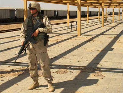 Maintaining security during a patrol through an abandoned train station near Bayji, Iraq.