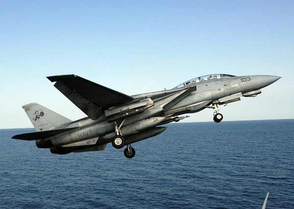 A Tomcat takes off.