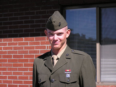 GREG, HOME AFTER BASIC TRAINING. HE IS A MARINE NOW!! PICTURE TAKEN IN FRONT OF CHURCH ON SUNDAY OCTOBER 3rd, 2004