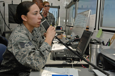 U.S. Air Force Staff Sgt. Brenda Davis, 433rd Tanker Airlift Control Element (TALCE), communicates with incoming aircraft at Naval Auxiliary Landing Field San Clemente, Calif., April 16, 2011, in support of Patriot Hook 2011. Patriot Hook is an annual Air Force Reserve TALCE exercise simulating a joint force response to a natural disaster in a forward deployed location. The exercise deploys three TALCE units and brings together units of the Air Force Reserve, Navy, Department of Homeland Security and other federal agencies to practice cargo planning and handling procedures. U.S. Air Force photo by Staff Sgt. Donald R. Allen (Released)