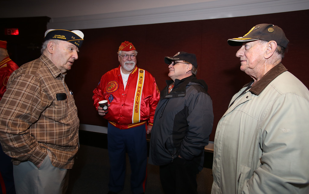 . Greater Lowell Veterans Council\'s Pearl Harbor Day observance at Lowell Memorial Auditorium. From left, John King, Ron Roy, John Coffman, and Walter Early, all of Lowell. (SUN/Julia Malakie)