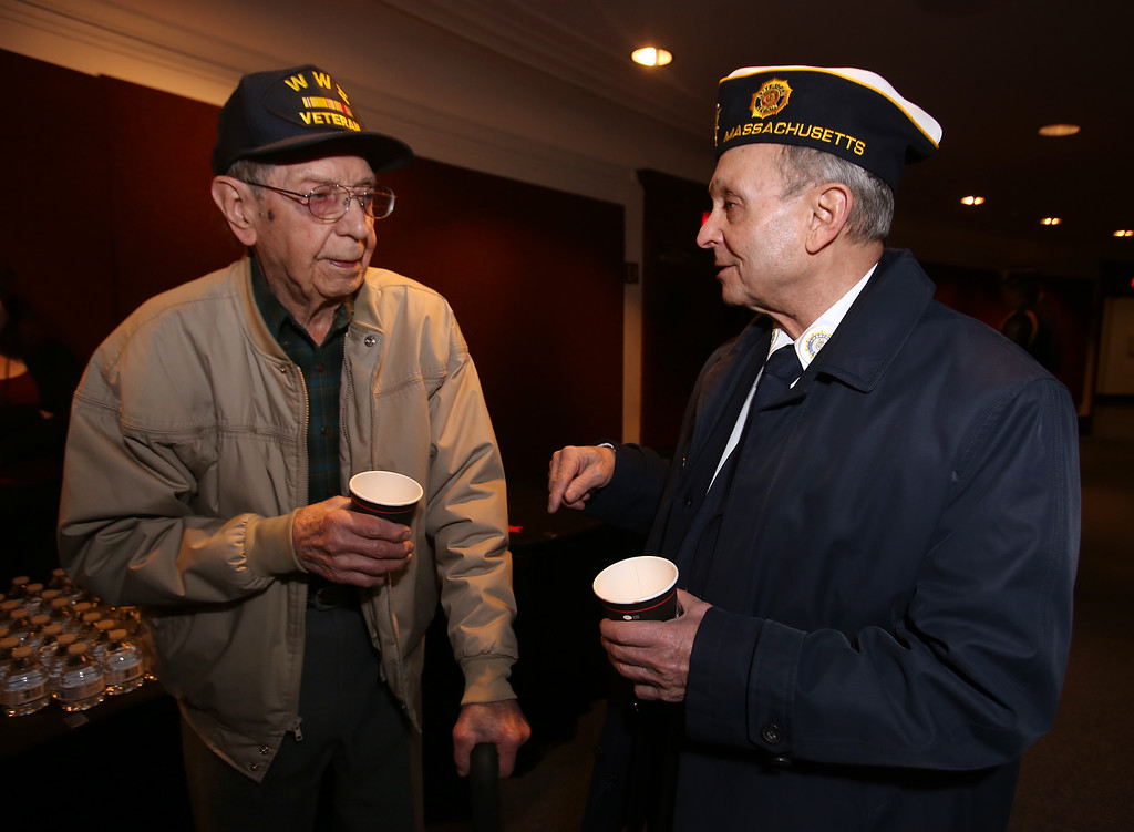 . Greater Lowell Veterans Council\'s Pearl Harbor Day observance at Lowell Memorial Auditorium. WWII veteran Henry Naruszewicz, who will turn 103 on January 3, left, and Vietnam-era veteran Joe Zangri of Billerica, commander of American Legion Sub-District 5. Naruszewicz was in the Field Artillery in Patton\'s 3rd Army. (SUN/Julia Malakie)
