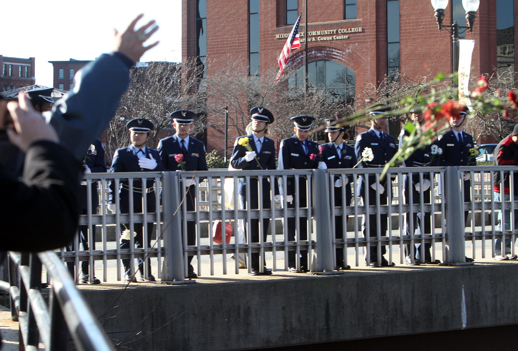 . Water ceremony, tossing flowers in the canal, at Greater Lowell Veterans Council\'s Pearl Harbor Day observance at Lowell Memorial Auditorium. (SUN/Julia Malakie)