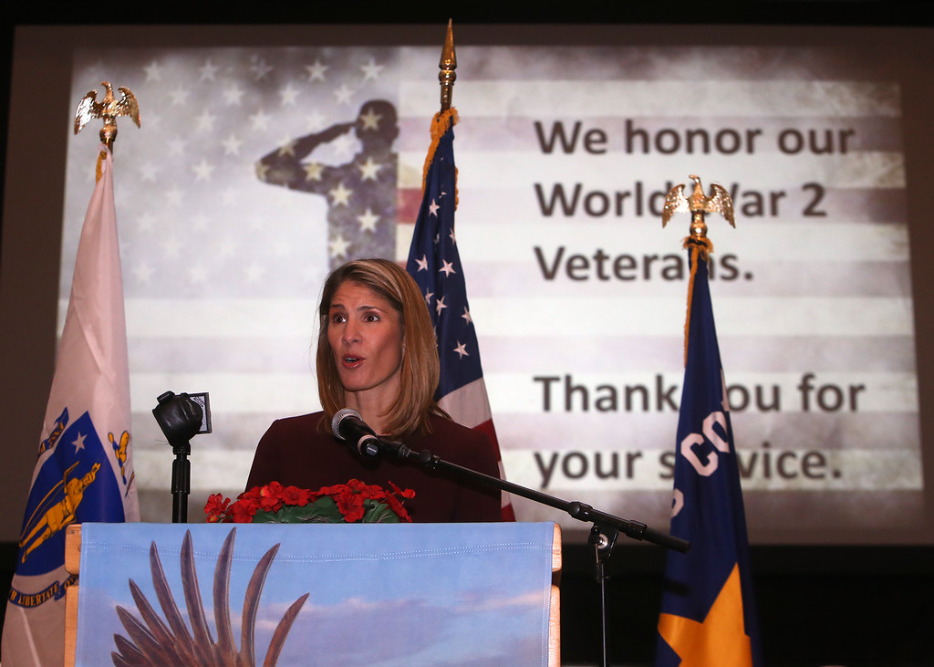 . Congresswoman-elect Lori Trahan speaks at Greater Lowell Veterans Council\'s Pearl Harbor Day observance at Lowell Memorial Auditorium. (SUN/Julia Malakie)