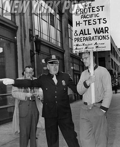 The New York Air Raid Warden orders a protester to take shelter during an air-raid drill