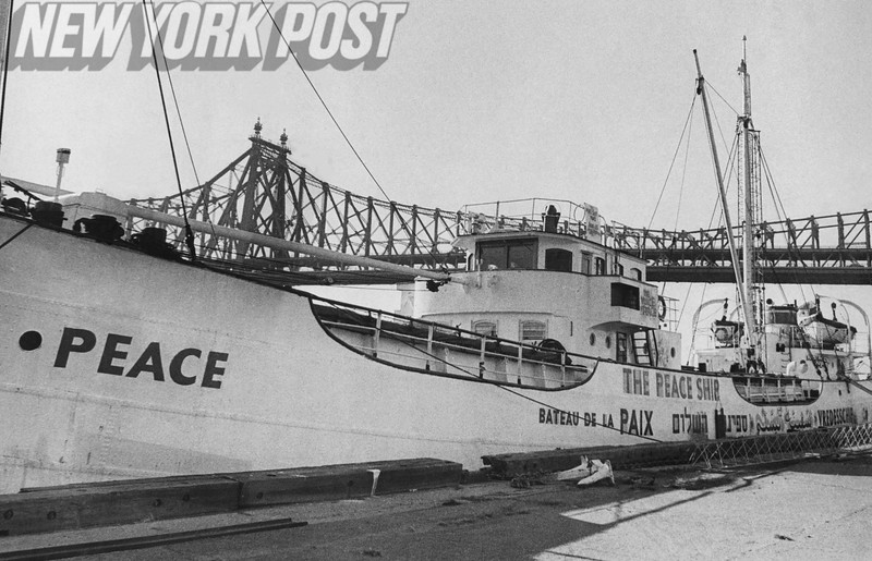 Peace Ship anchored at the East River with the Queensboro Bridge in the background. 1969