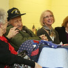 Ernie Blasetti of Ayer with his significant other Alice Langford, left, daughters Tam Blasetti of West Hartford, Conn., center, and Joanna Bowolick of Lancaster, after being presented with a handmade quilt from Central MA Quilts of Valor. (SUN/Julia Malakie)