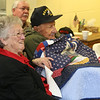 Ernie Blasetti of Ayer with his significant other Alice Langford, after being presented with a handmade quilt from Central MA Quilts of Valor. (SUN/Julia Malakie)